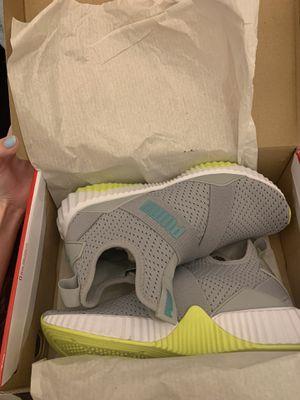 BRAND NEW Puma Women's 7 1/2 Defy Mid Core Sneakers (never worn) for Sale in Queen Creek, AZ