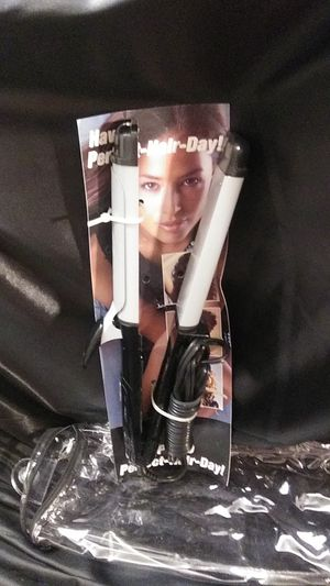 Revlon straightener and curling iron in one. for Sale in Raleigh, NC