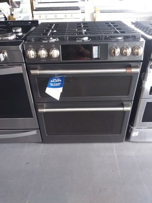 Beautiful Samsung double door gas oven/ with smart phone connection for Sale in Houston, TX