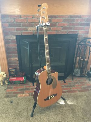 Fender Kingman acoustic 4 string bass guitar. On board tuner, near mint condition. Plays great and was hardly ever used. Hard shell case included. for Sale in Wichita, KS