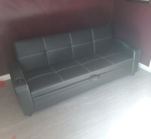 Sofa futon w/pullout bed & cupholders(faux leather) for Sale in Riverside, CA