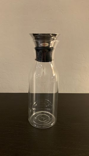 Clear glass water carafe, liquid holder with modern chrome topper for Sale in Las Vegas, NV