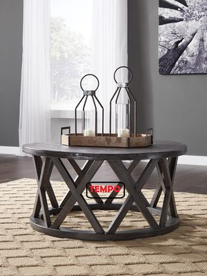 NEW IN THE BOX. ASHLEY FURNITURE GRAYISH BROWN ROUND COFFEE TABLE, SKU# T711-8C for Sale in Santa Ana, CA