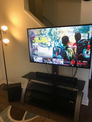Samsun Smart TV, size 55 inch and comes with a stand and a sound system for Sale in Big Rapids, MI
