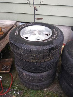 5 lug 15 inch rims and tires for a Chevy for Sale in Tacoma, WA