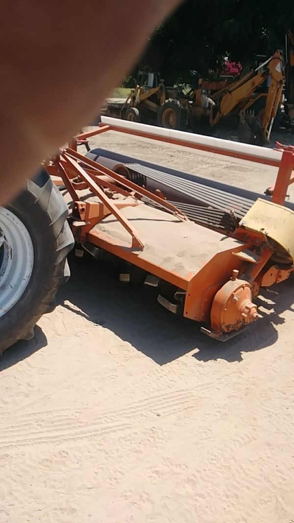 Rottillering large or small backhoe disc mow all kinds of tractor work