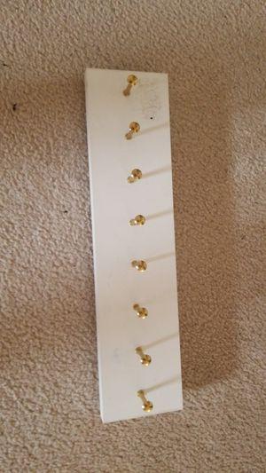 White 8 hook sliding closet/cabinet rack for Sale in Denver, CO