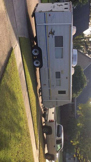 Truck and camper/toy hauler for Sale in Baton Rouge, LA