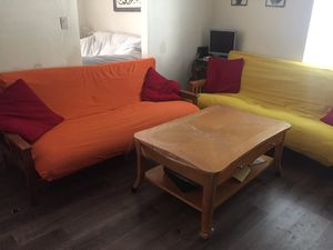 2 futons and one coffee table for Sale in Sacramento, CA