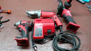 Milwaukee impact drill milwaukee grinder charger m12 m18 milwaukee sheer but sheer is missing cutting attachments for Sale in Riverside, CA