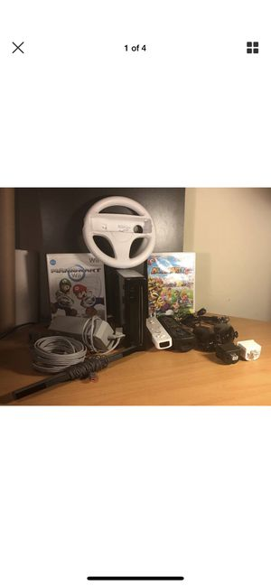 Nintendo Wii Black Console Complete with 2 Games Mario Kart & Mario Party 8. 2 controllers, 2 joy sticks and wheel for Sale in Bethesda, MD