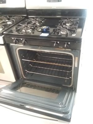 Whirlpool gas stove stainless steel used good condition 90days warranty for Sale in Mount Rainier, MD