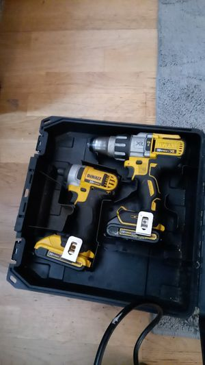 DeWalt brushless hammer drill and regular impact in a hard case with batteries and charger for Sale in Springfield, OR