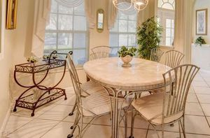 Travertine marble dining table with 6 chairs for Sale in Jupiter, FL