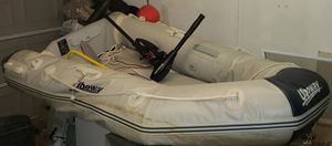 2 man Inflatable boat, trolling motor, and battery for Sale in Hazelwood, MO