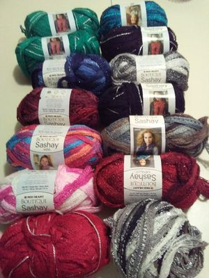 Red Heart Sashay, Premier Starbella, Willow Aura and chenille ruffled scarf yarn. for Sale in Oak Lawn, IL