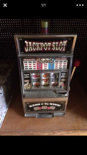 Toy slot machine collectible item Not real decorative only but does work like one for Sale in Abington, MA
