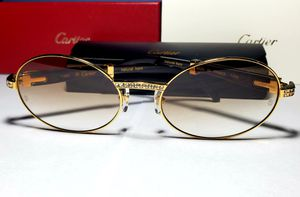 Cartier gold and black diamond frame sunglasses for Sale in Bloomfield, CT