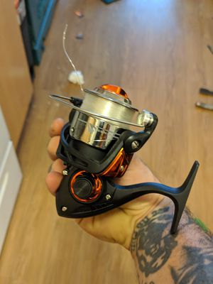 12 fishing poles couple fly rods and some reels for Sale in Portland, OR