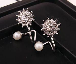 Silver Sunburst and Pearl Cuff Earrings for Sale in Woodbridge, VA