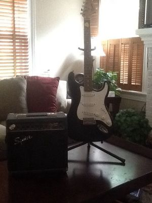 Squier Strat Guitar by Fender w/ Stand &Amplifier for Sale in Houston, TX