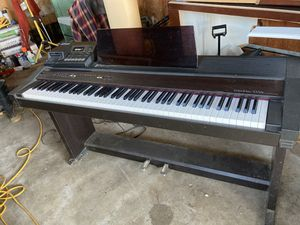 Roland digital piano contemporary black and Roland MT-100 digital sequencer and sound module.. for Sale in Arlington, WA