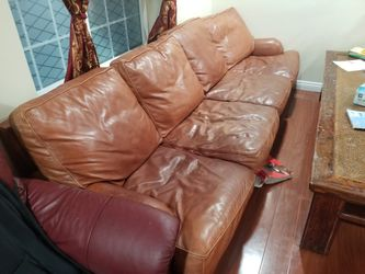 Free Long Leather Sofa Brown for Sale in Garden Grove,  CA
