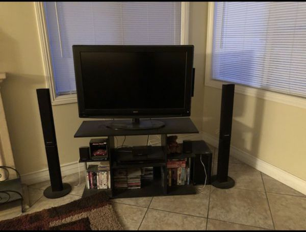 Entertainment ctr tv with blue ray and movies/music cds!