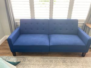 Navy blue couch/futon for Sale in Orlando, FL