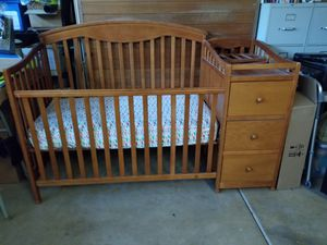 Baby crib with attached changing table. for Sale in Riverside, CA
