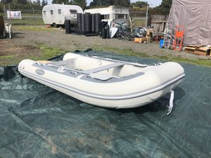 """West marine AL 360 aluminum bottom inflatable boat 11'6"""" total length never been in water sells for $1599 for Sale in Salem, OR"""