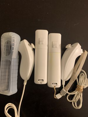 2 Wii Controllers with nunchucks for Sale in Marietta, GA