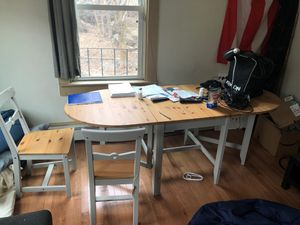 Foldable elegant table with two chairs included! The table folds and is perfect for a smaller breakfast table or a full dinner table. for Sale in ROXBURY CROSSING, MA