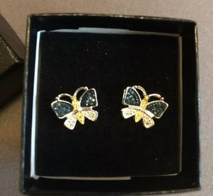 Stylish Womens 14K White Gold Over Solid Sterling Silver 1/4 CTW 50 Diamonds Butterfly Designer Earrings for Sale in Tallahassee, FL