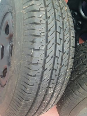 5 tires with rims for Chevy silverado 1500(235/85R16) 4 in good condition and 1 tires need replaced for Sale in Port Richey, FL