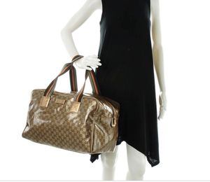 Gucci Crystal Bronze Monogram Small Duffle Bag for Sale in Swansea, IL