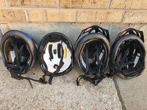 4 bike helmets . for Sale in Rolla, MO