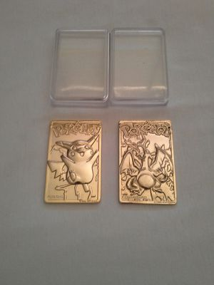 Nintendo Pokemon Pikachu Gold Plated Made In Year 1999 Great Condition $20. Charizard Acceptable Condition $10 for Sale in Reedley, CA