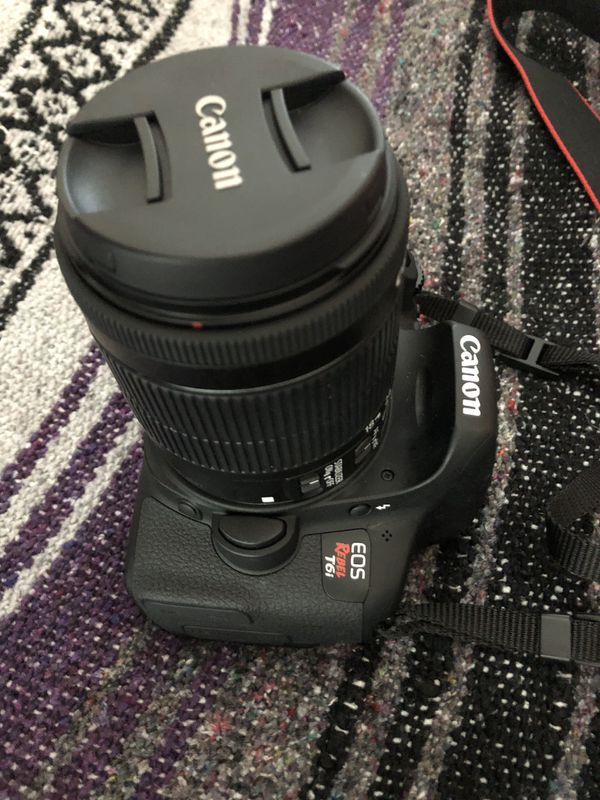 Canon Rebel T6i body with 18-55 mm zoom lens