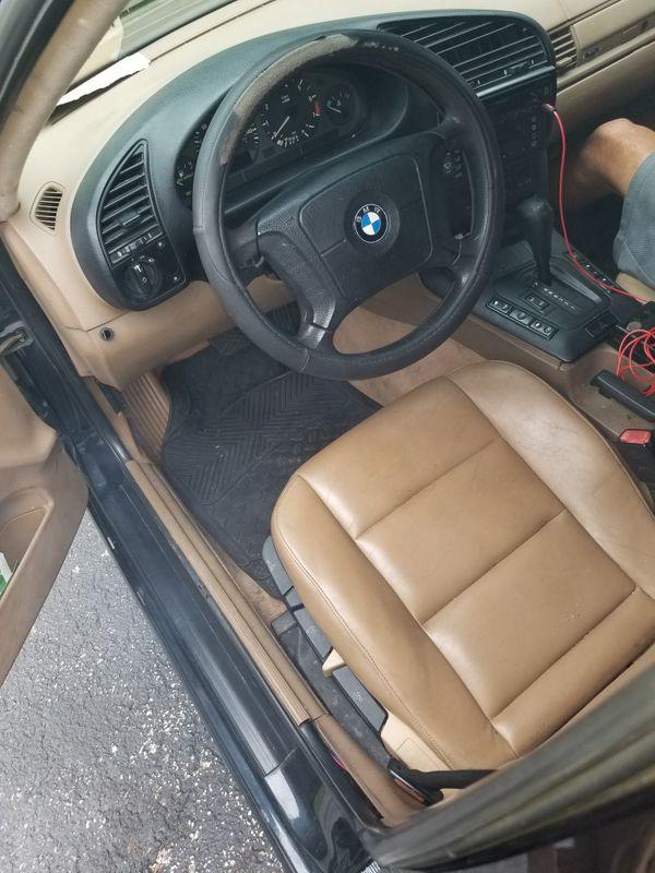 BMW 318i 97 with BMW sports rims my lost ur win