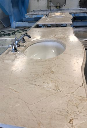 Two vanity top with two Undermount sinks Koehler one and a quarter OG edge material cream marfill 8 inches spread faucet very nice condition size ap for Sale in West Palm Beach, FL