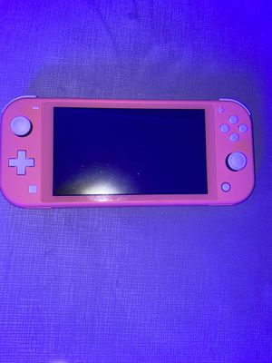 Nintendo Switch Lite Coral bundle with animal crossing for Sale in Chicago, IL