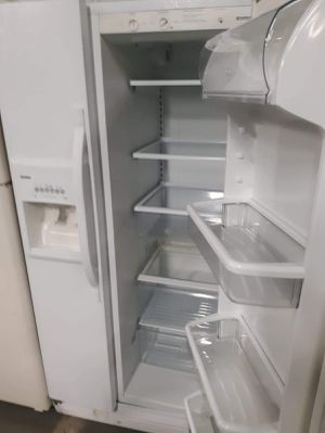 Kenmore side by side doors fridge working perfectly for Sale in Baltimore, MD