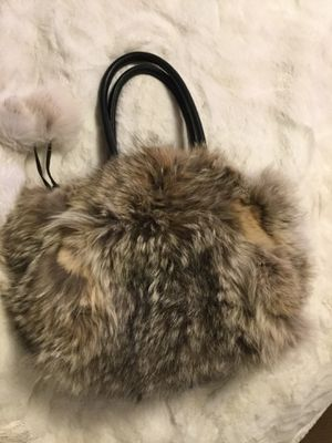 Coyote fur purse with Pom poms and soft black leather for Sale in Denver, CO