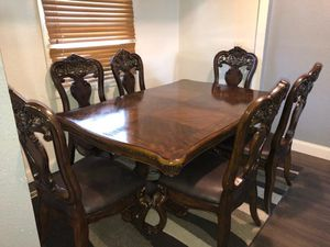 Rectangular dark wooden dining table with 6 chairs for Sale in Fort Wayne, IN