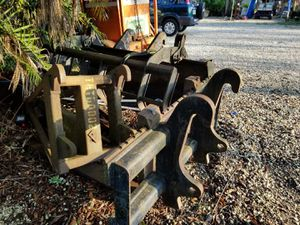 Grapples, Forks & Tree Boom for a Caterpillar Combination Loader Backhoe Quick Release Attachment for Sale in Miami, FL