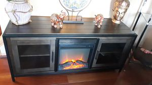 """BELLO - TV Stand MODEL TCA63-90215 .WITH FIREBOX HEATER INSTALLED...Most TVs Up to 75""""-WaxyMAHAONY BROWN.. DETAILS SEE BELOW...63X24X20..PRICE IS FIRM for Sale in West Chicago, IL"""