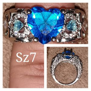 Beautiful sterling silver ring. Large lab topaz heart. Angel wing design on sides. Size 7 for Sale in Glen Burnie, MD