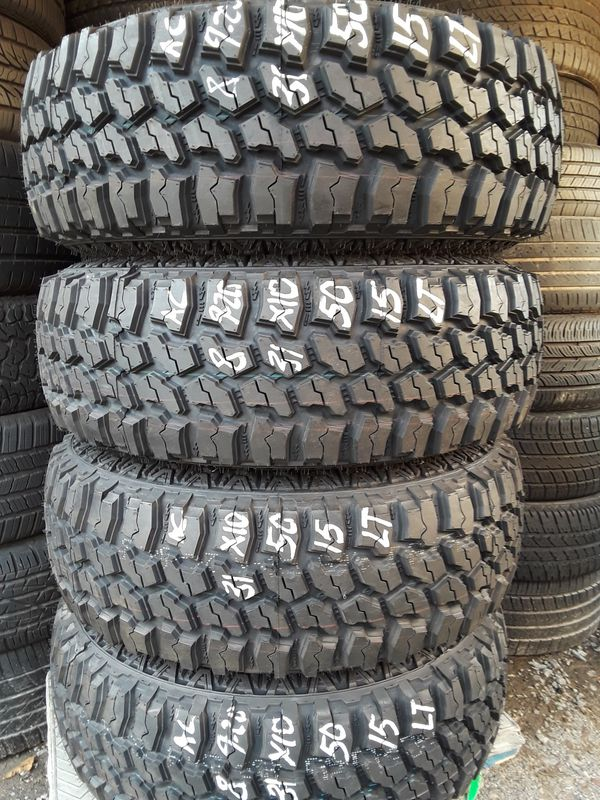 SET OFF 4 BRAND NEW RIMS AND TIRES.31x10.50-15 LT FOR JEEP TRUCKS