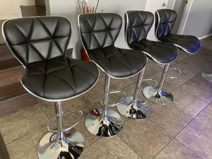 Brand new set of 4 black bar stools (premier) / black pub stools (premier) height adjustable and swivel (price is firm) for Sale in San Antonio, TX